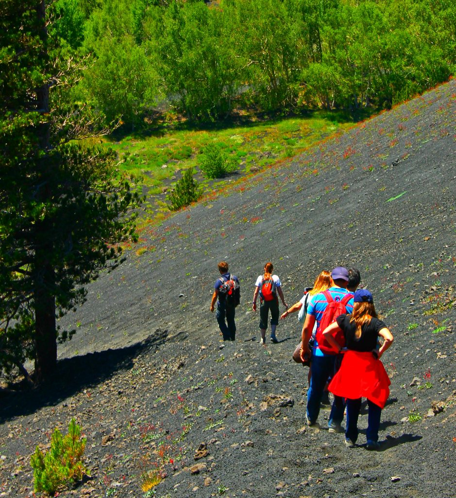 a group on Etna with a guide