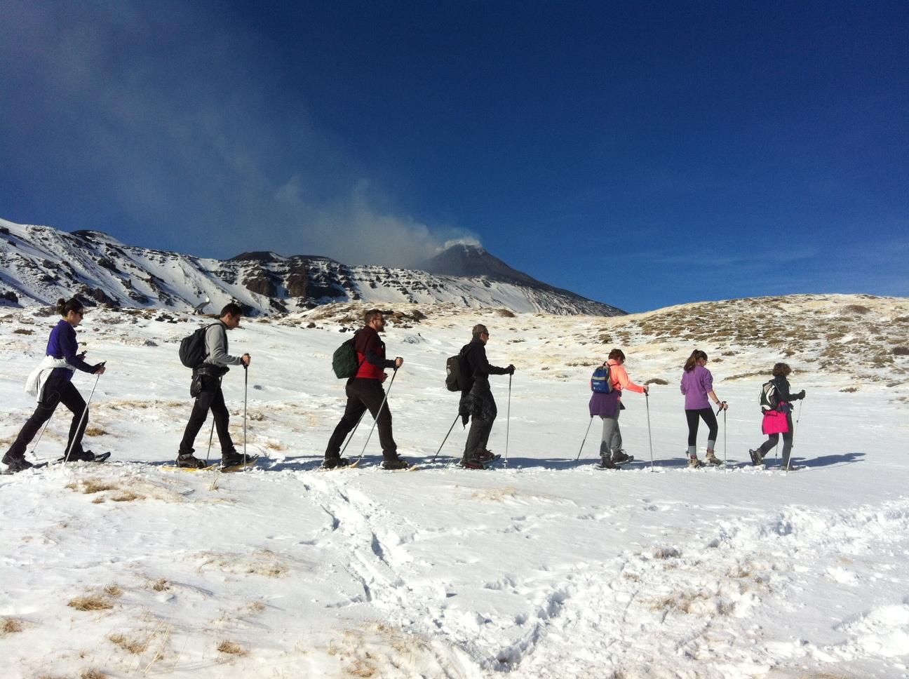 etna trekking tour snowshoes