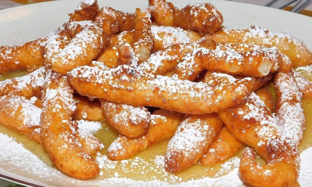 crispelle. Sicilian desserts made with rice and honey