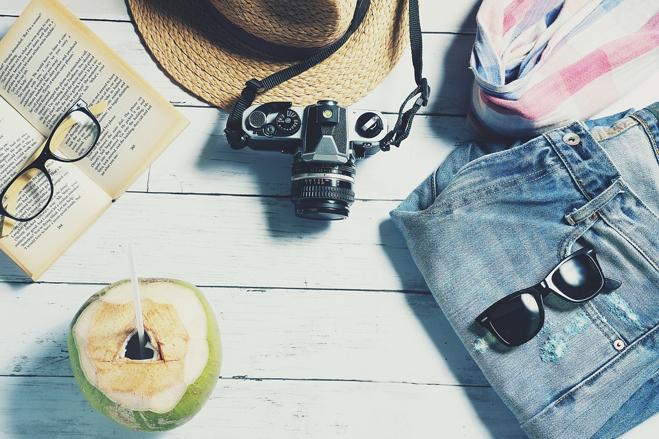 Camera, dresses, hat and sunglasses: all the necessary for summer
